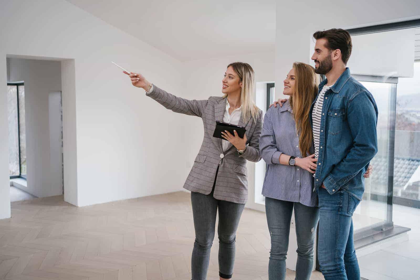 real estate broker showing home