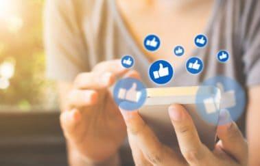 woman liking posts on social media