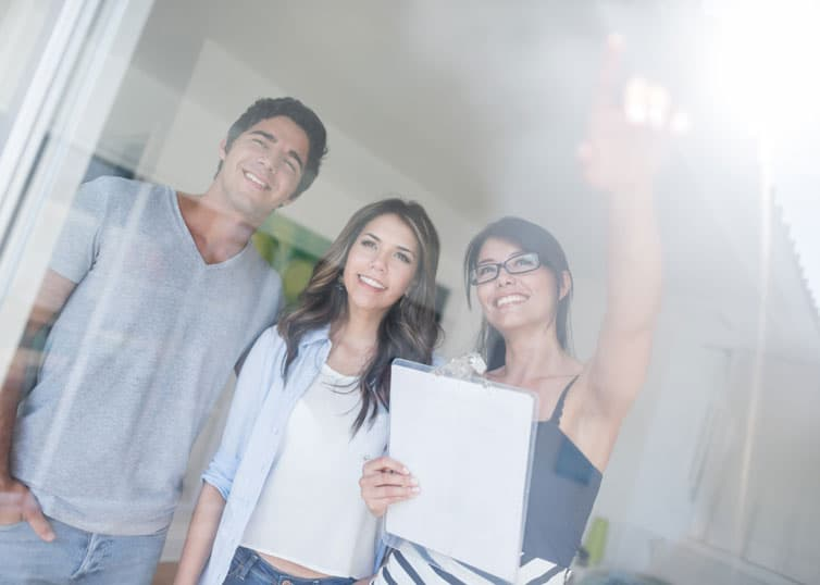 Young couple buying a house from a broker who's an expert in the local North Carolina real estate market