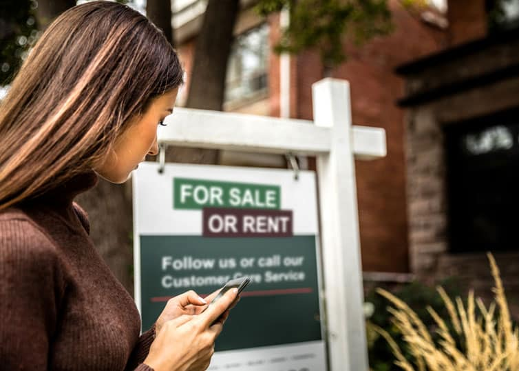 """North Carolina real estate investor checking out a property with a """"for sale or rent"""" sign"""