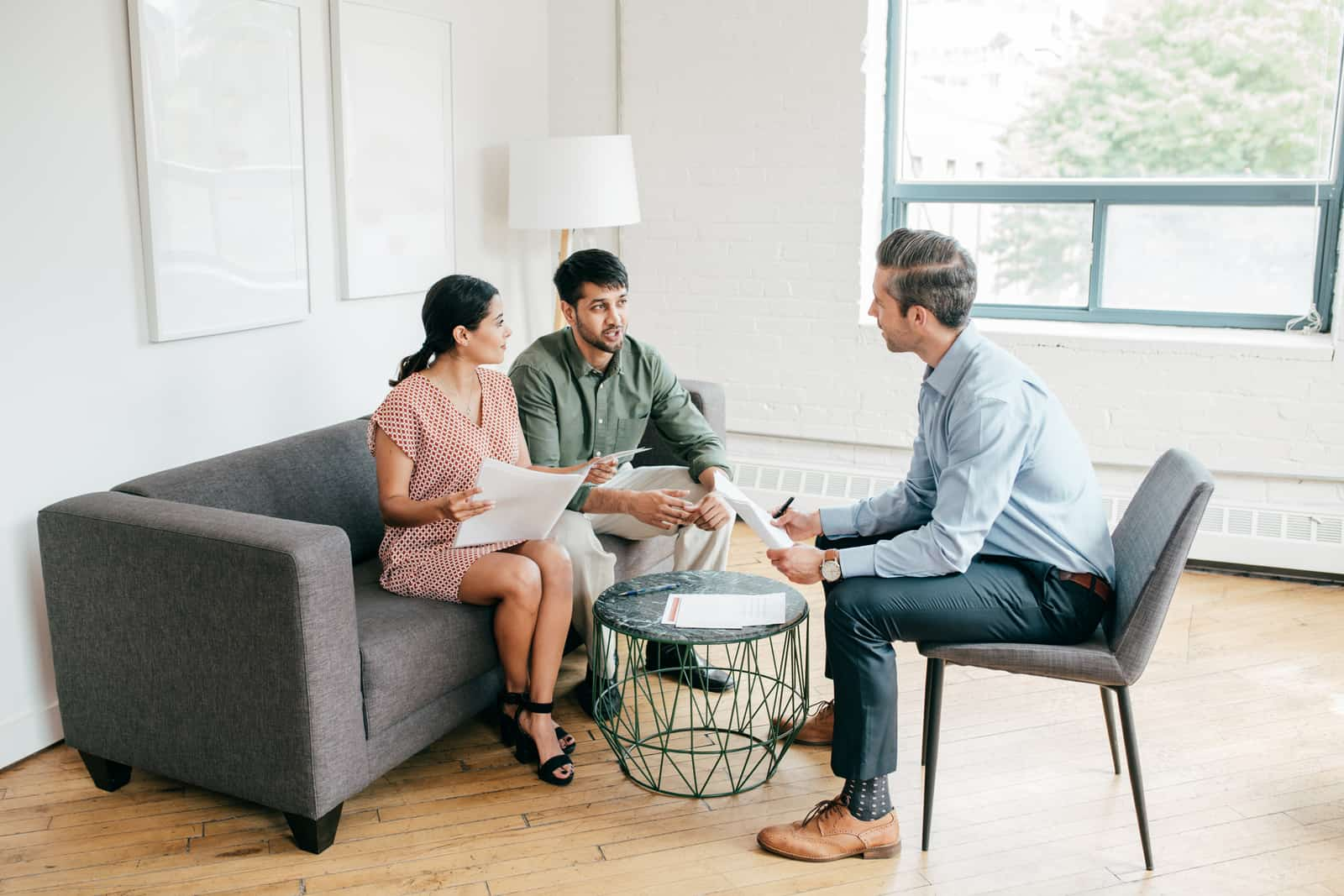 real estate agent talking to clients