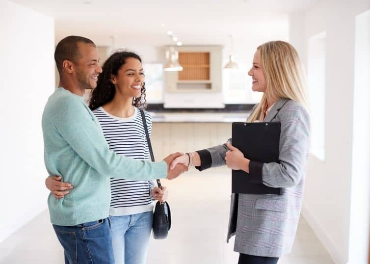 North Carolina real estate broker showing a home to a young couple