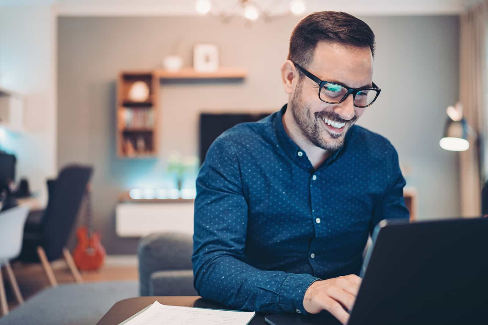 Businessman using laptop at home