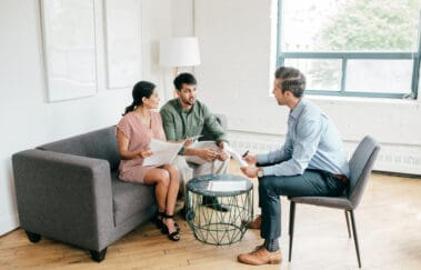 North Carolina real estate broker meeting with a young couple