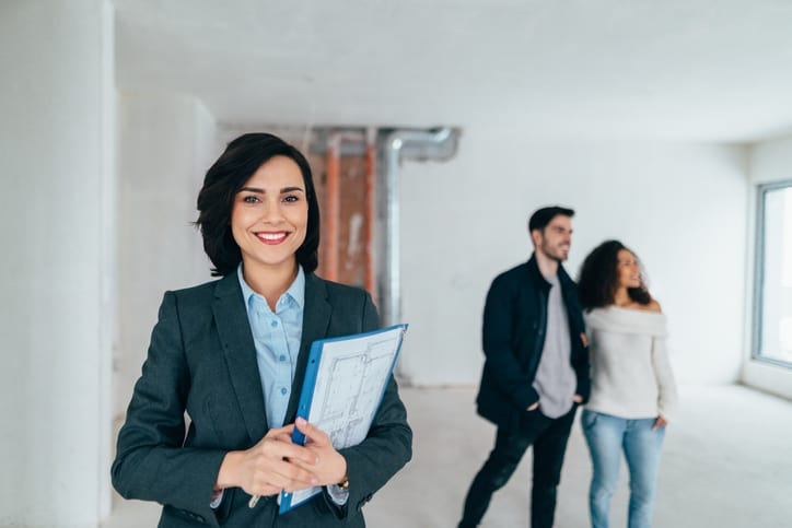 Real estate professional smiling to the camera