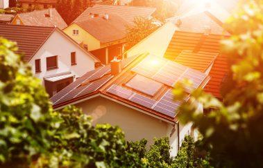 Solar panels on tiled roof of house in residential neighborhood