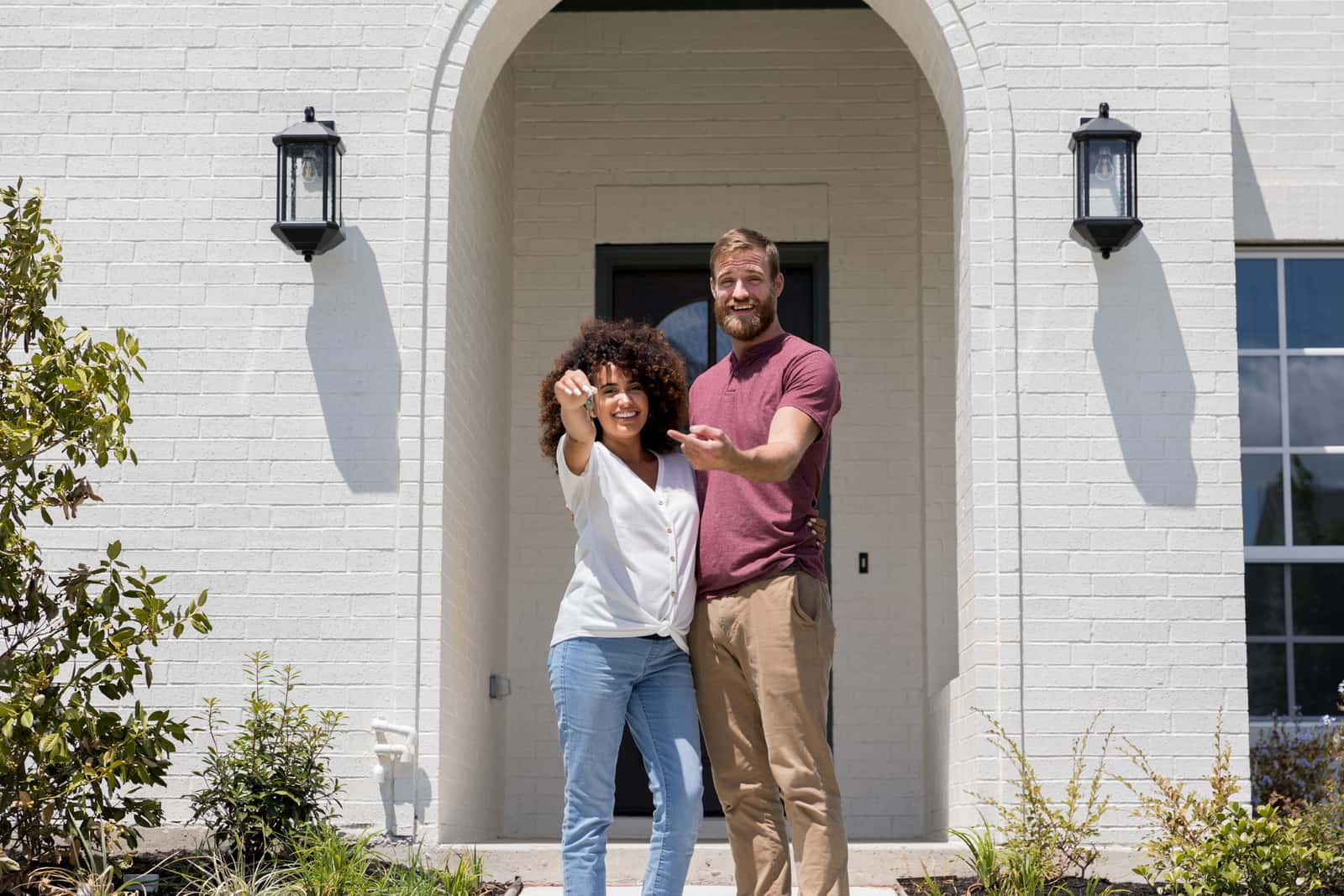 Excited couple show off new home