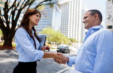 Real estate broker greeting an appraiser with a handshake to promote a positive appraiser-broker relationship