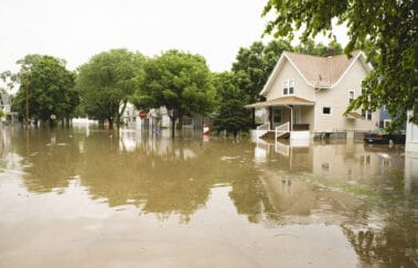 Water floods residential neighborhood, homeowners' flood insurance concept
